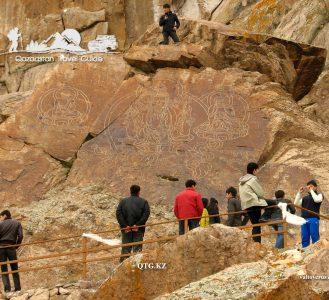 Petroglyphs «Tamgaly Tas» Buddhist drawings, pi Ili. Kazakhstan.